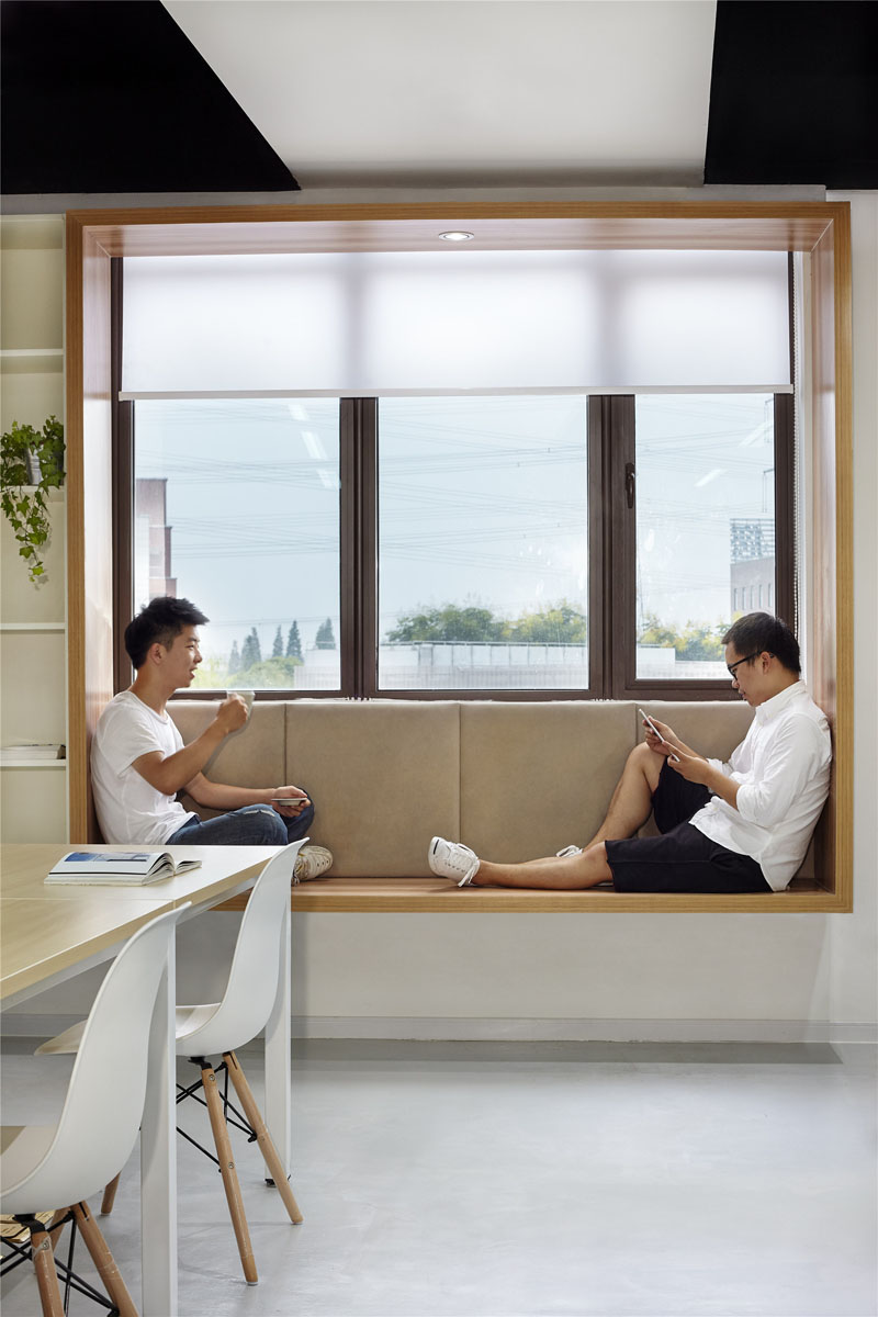 a minimalist space and semi sheer window shades that keep the space private enough yet let light inside