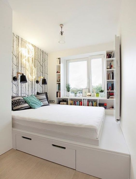 a minimalist white platform bed with a single drawer for storage is a nice solution for a small bedroom