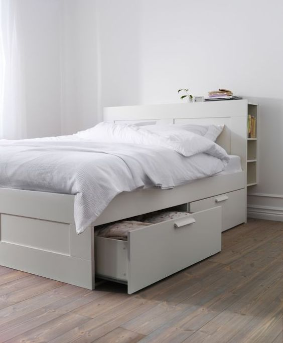 a neutral IKEA Brimnes bed with drawers and a storage headboard is a cool solutioin for a small space