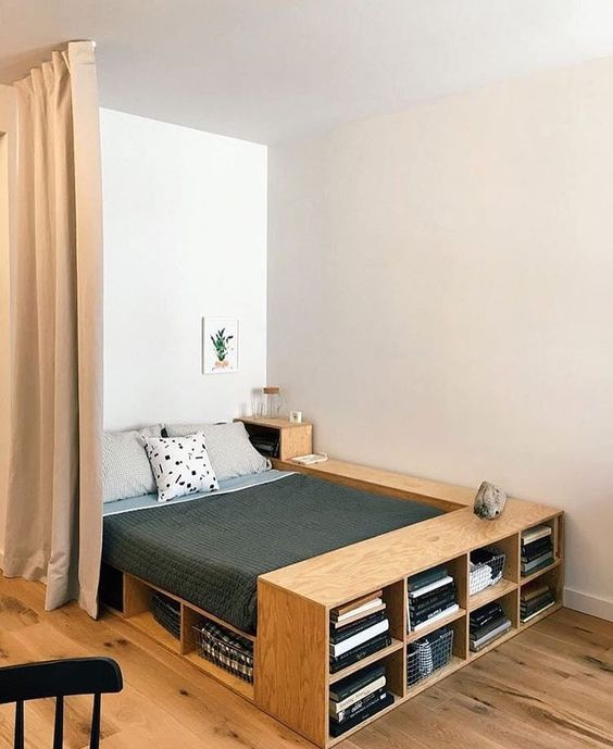 a plywood bed with plenty of storage - open storage compartments and an additional nightstand