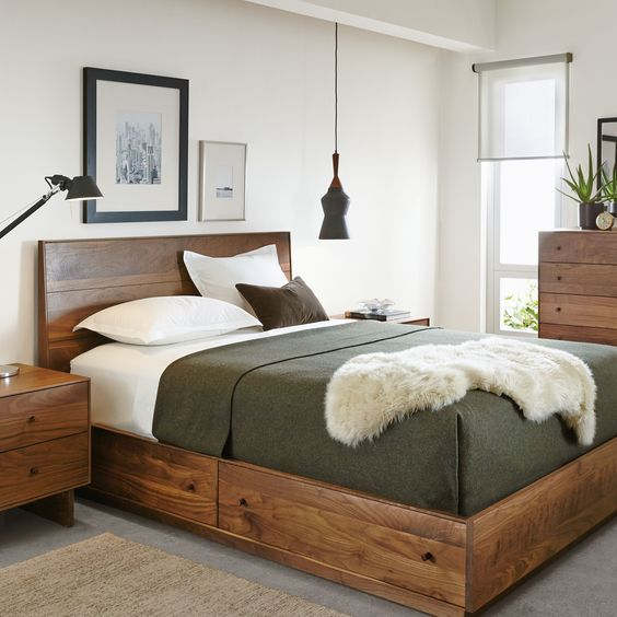 a rich stained bed with drawers with knobs is a very comfortable piece for rocking
