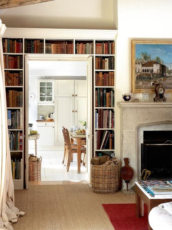 a vintage space with open bookshelves over the doorway is a lovely idea to store books and make the space look cool and chic