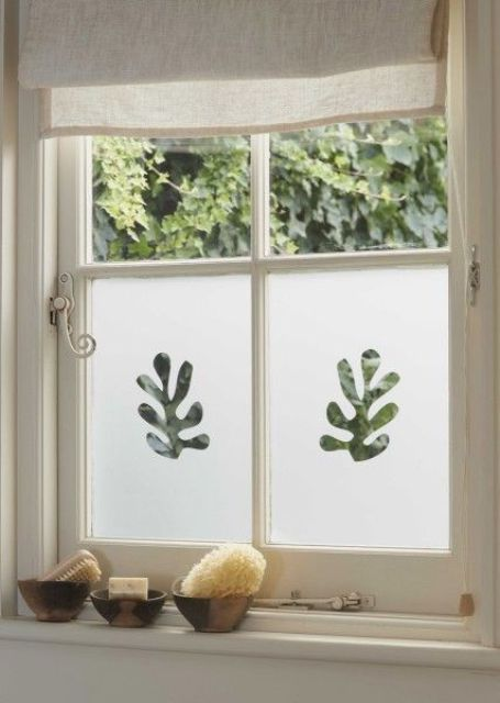 bathroom windows done with decorative frosting film to make the space more private