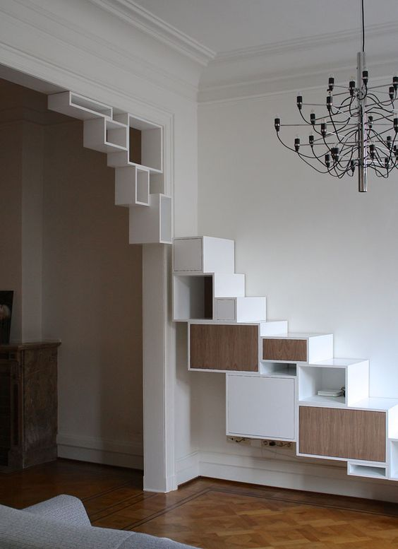 creative contemporary wall and doorway styling with minimalist open and closed shelves running upwards is a cool idea for storage in a whimsy way