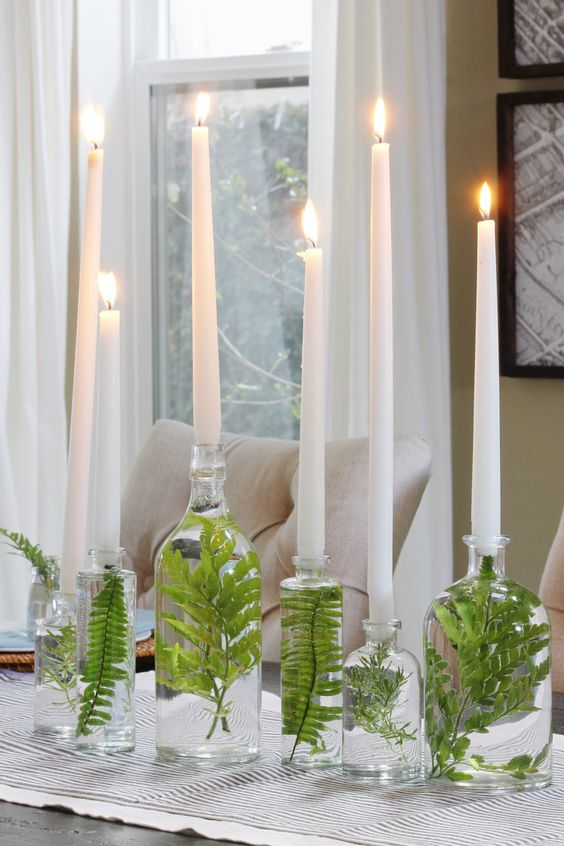 elegant Nordic decor of bottles, leaves inside and candles to decorate a Scandinavian space for spring