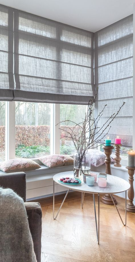 neutral fabric shades covering the whole corner window if necssary are a cool way to keep the space more private yet modern
