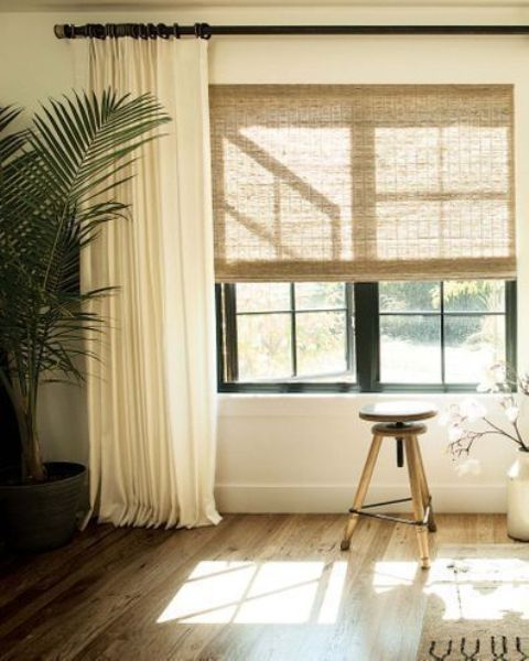 neutral woven shades paired with creamy curtains look very nice and keep the space all-private and welcoming