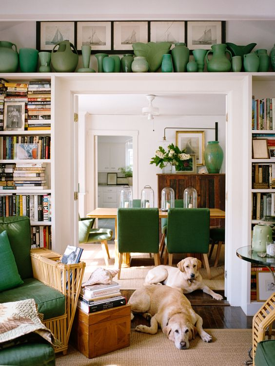 open shelves around the doorway and a long shelf over it are used to display vases and books is a cool idea to incorporate a touch of color and store things