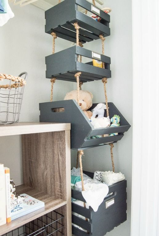 painted pallet boxes hanging on ropes in the corner provide much storage space using the dead space in the corner