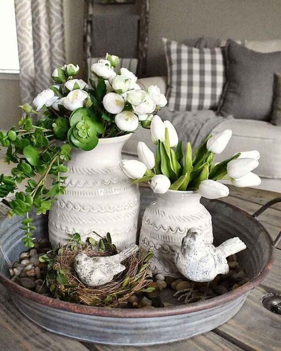 rustic Scandinavian decor with a galvanized tray with greenery and a fake nest with birds, white blooms and greenery