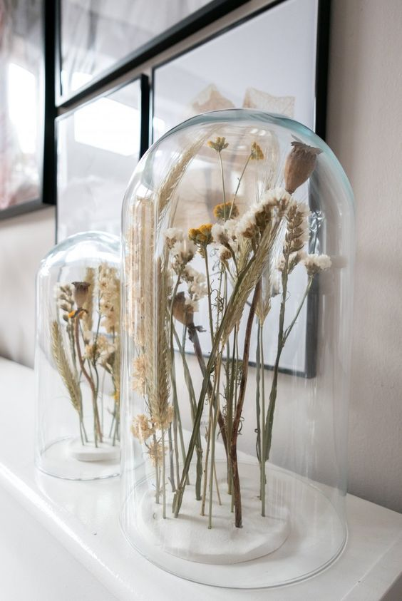 simple and chic Scandinavian decor - dried blooms and herbs in cloches are great for decorating for spring and such decor will last long