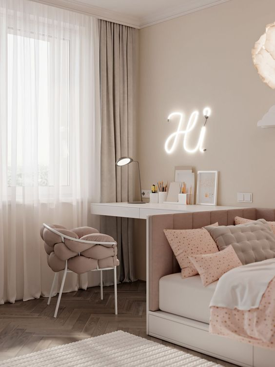 a beautiful white and dusty pink teen girl bedroom with various printed textiles, a neon light and a table lamp
