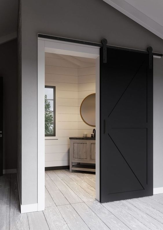 a black and white sliding barn door brings a rustic feel with a modenr touch at the same time