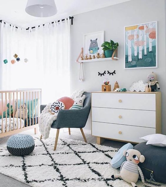 a bright contemporary nursery in white with touches of muted colors here and there is very welcoming and chic