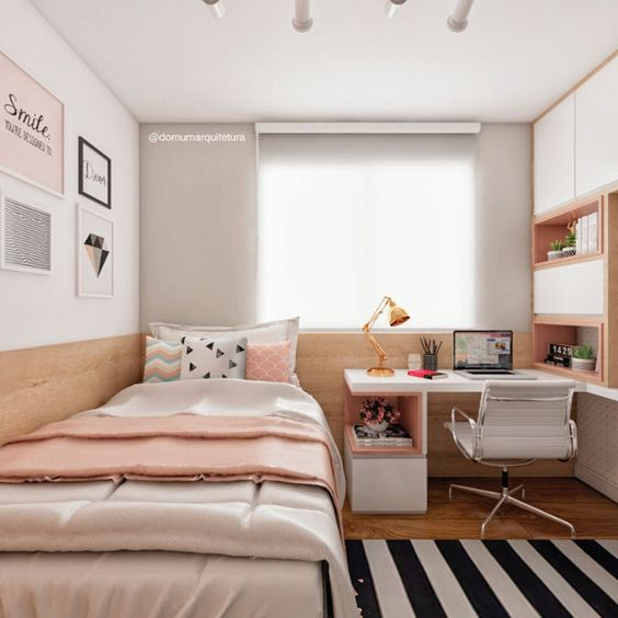 a chic well-organized modern teen girl bedroom in neutrals and light pink touches, with built-in furniure and touches of copper