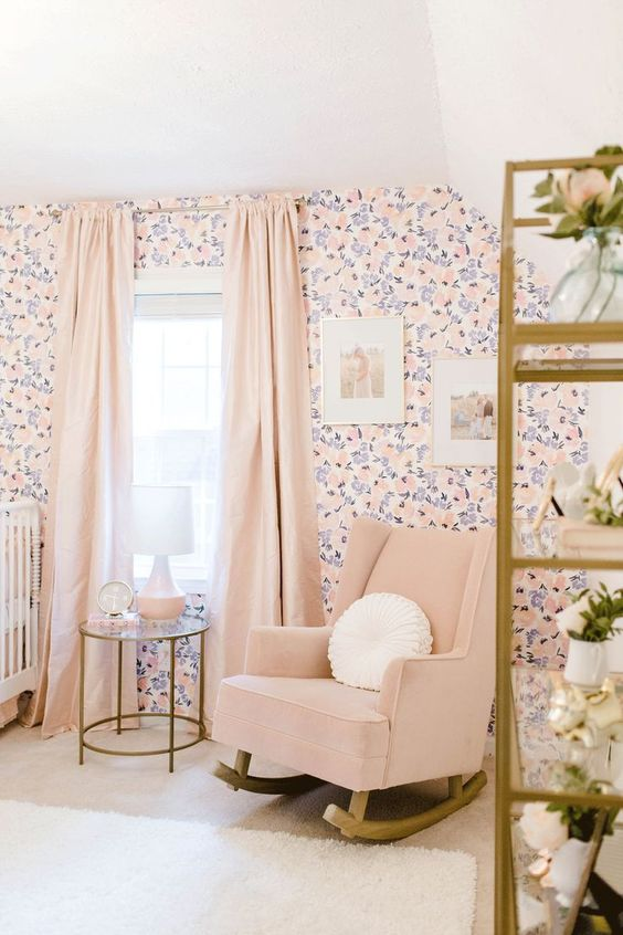 a girlish nursery with a floral wall, a blush rocker, blush curtains and gilded touches is a cool idea