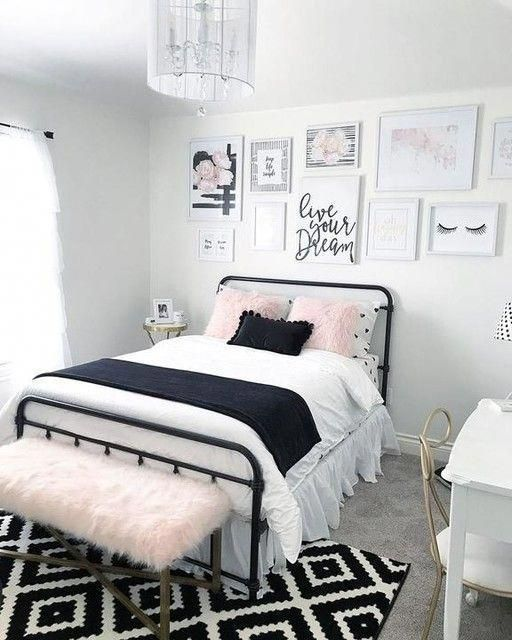 a girlish teen bedroom in black, white and blush, with a cool gallery wall, printed textiles and touches of brass
