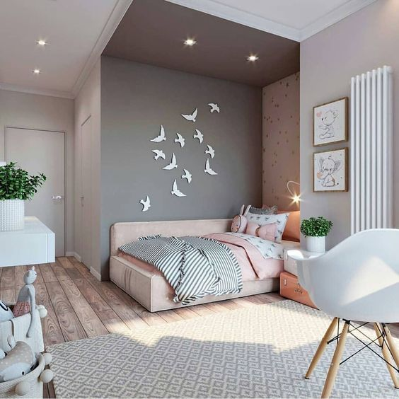 a lovely pink and grey teen girl bedroom with a bed in an alcove, bird art, potted greenery and cute artworks