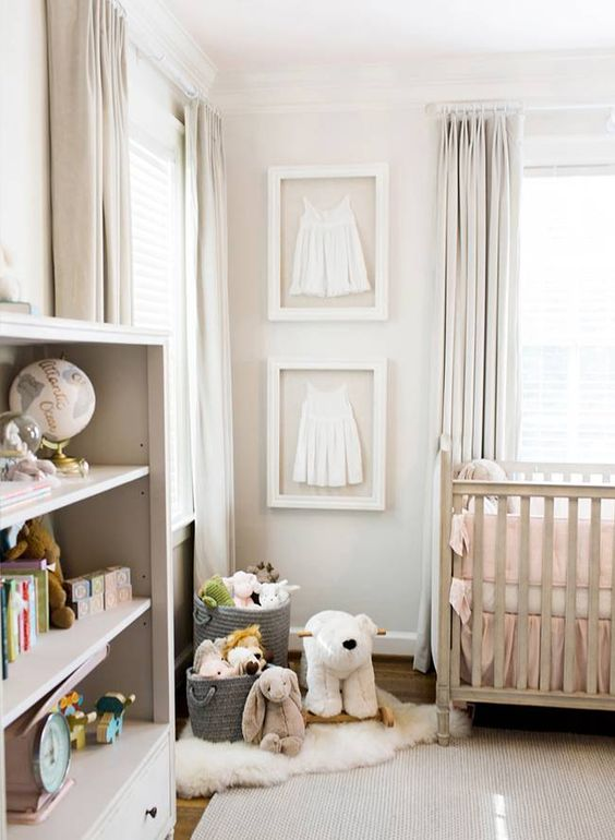 a neutral nursery with blush bedding, modern furniture, creamy curtains and a creamy rug is all chic