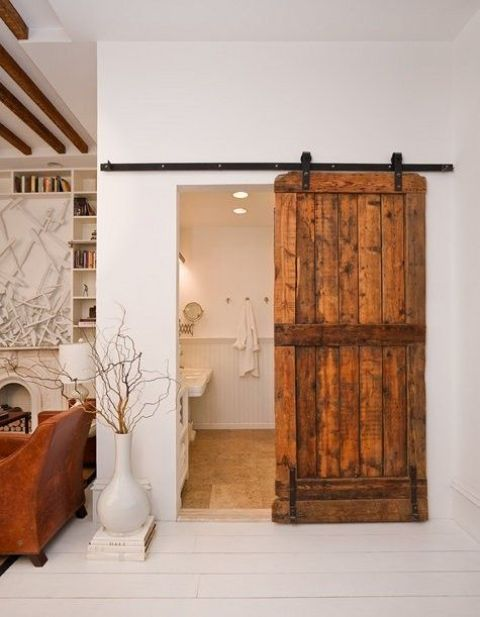 a rustic sliding barn door is a cool idea to cozy up the space