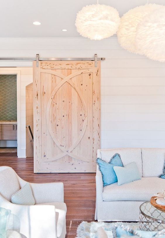 a rustic textural and patterned sliding door catches an eye and makes the space cozier