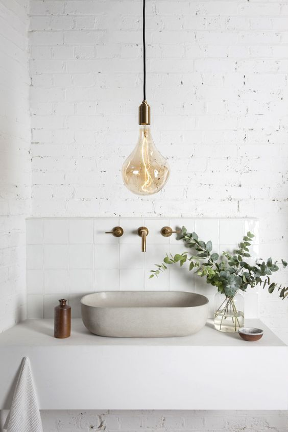 a single large bulb pendant lamp with a brass base is a cool and stylish modern idea to rock