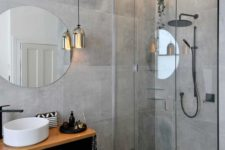 a single pendant lamp of mirror glass brings a more modern feel to the space and makes it cooler