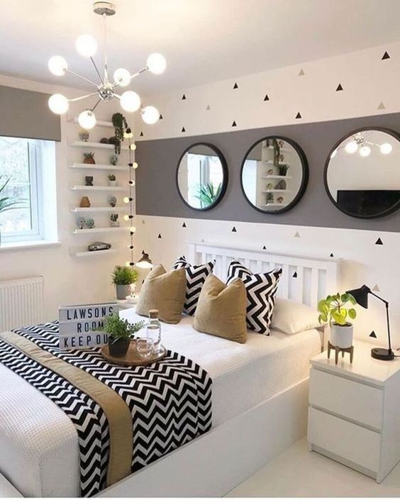 a stylish and playful teen girl bedroom in white, grey and black, with tan touches, geometric prints and greenery