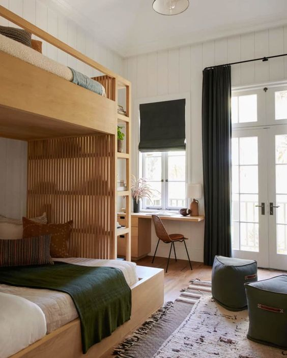 a stylish modern farmhouse shared teen bedroom with a plywood bunk bed, a desk, green ottomans and textiles