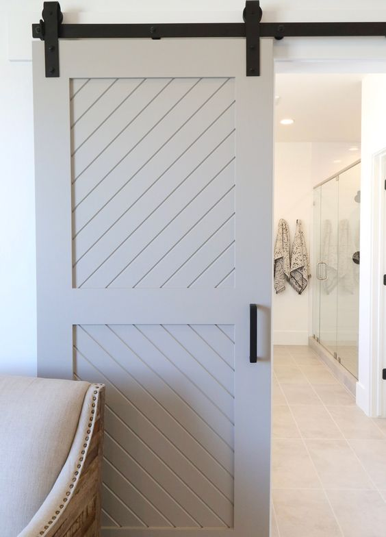 a whitewashed sliding barn door with black touches will add a rustic touch but a stylized one
