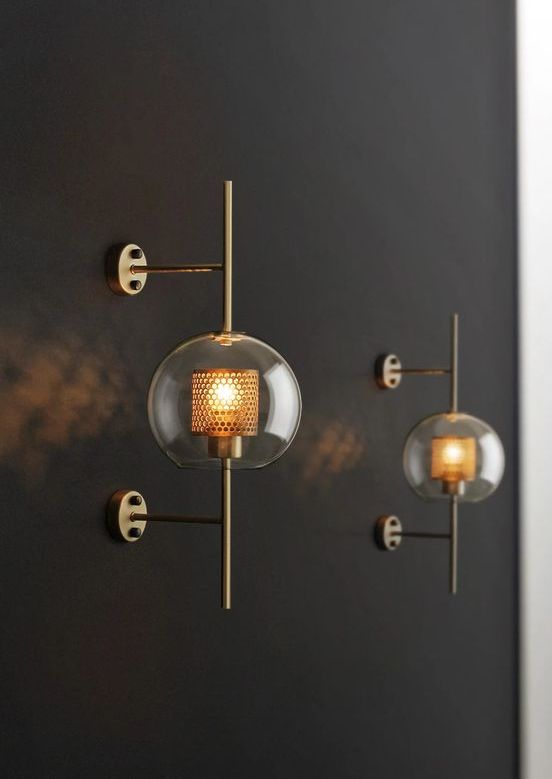 catchy brass wall lamps of glass spheres and mini lampshades inside look chic and very bold