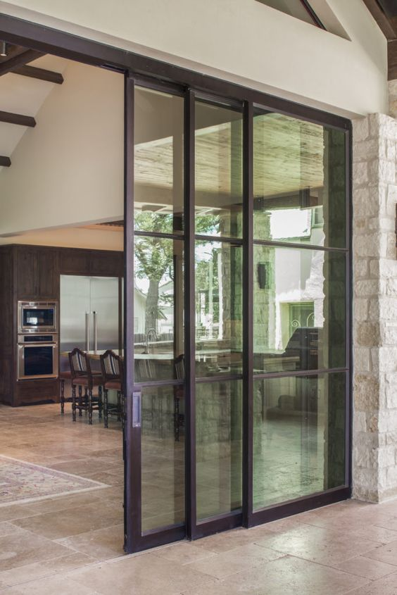 glass sliding doors are great to separate the indoor and outdoor spaces and brings much light inside