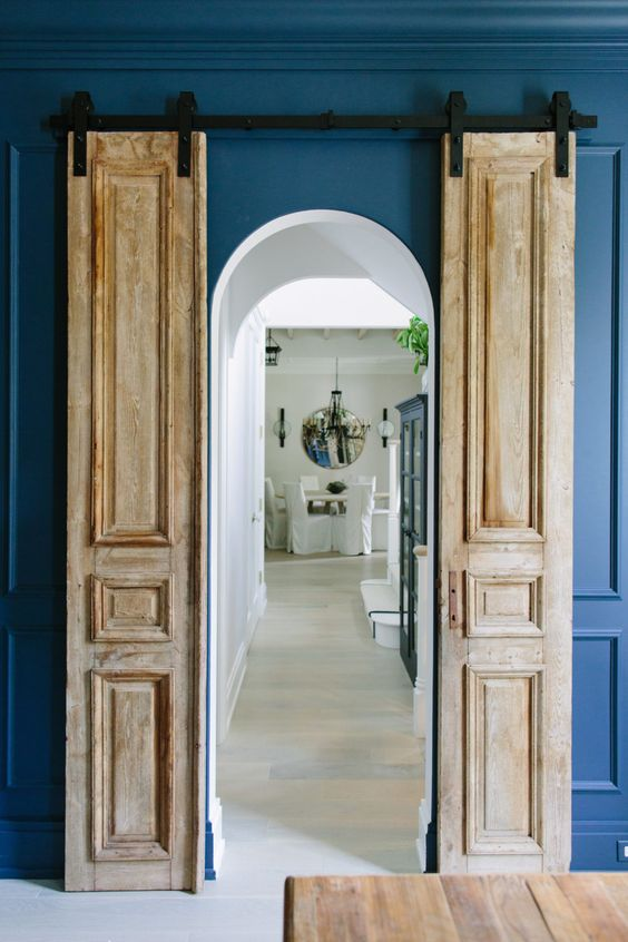 such antique doors made sliding ones add chic and a bold look to the space