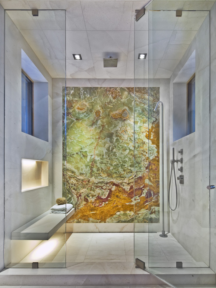 A marble walk-in shower with a wall that looks like a piece of art. (186 Lighting Design Group - Gregg Mackell)