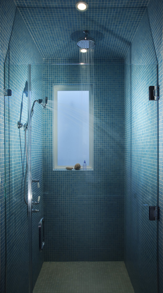 Blue mosaic tiles and a frosted glass window looks great together. (Leonard Grant Architecture)