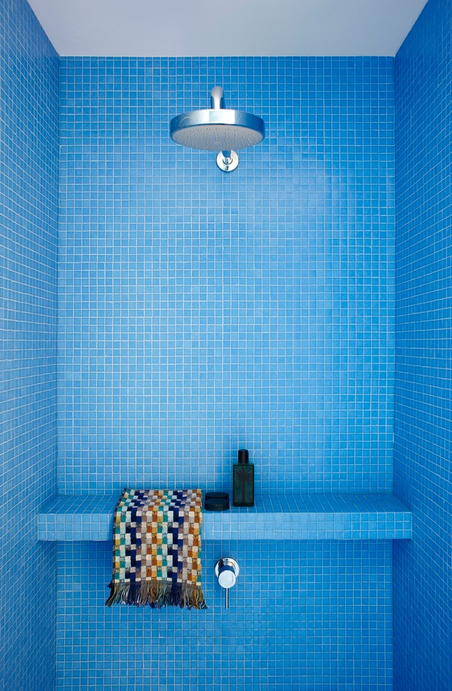 A minimalist shower covered only with blue mosaic tiles. (Scott Weston Architecture Design PL)