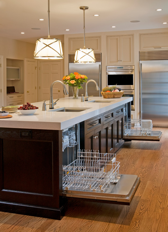 A luxurious kitchen island with two dishwashers at once. (Superior Woodcraft, Inc.)