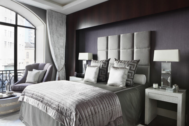 silk and velvet upholstered headboard creates great contrast with leather bedside tables in this gorgeous bedroom (Oliver Burns)