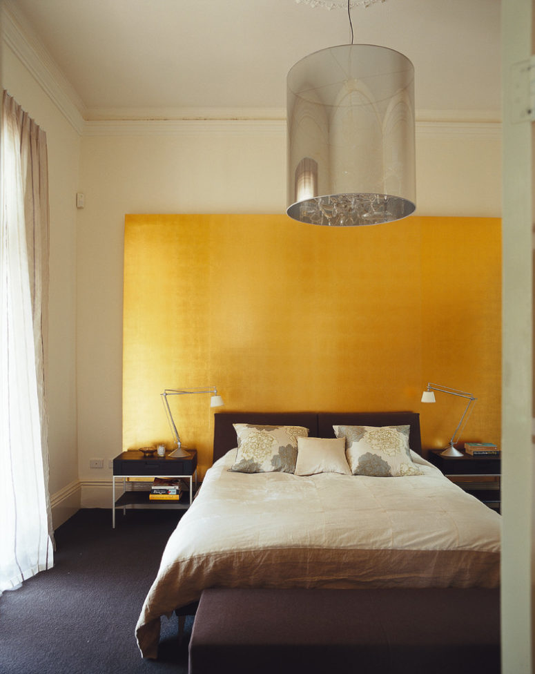 metallic furniture and shiny gold headboard are great for those who doesn't want a bedroom to be moody (Nexus Designs)