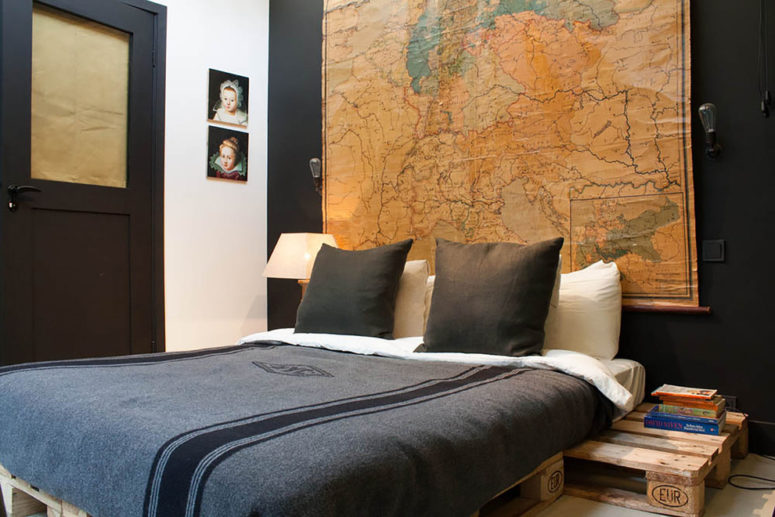 an oversized vintage map could become a gorgeous headboard in a bachelor's pad