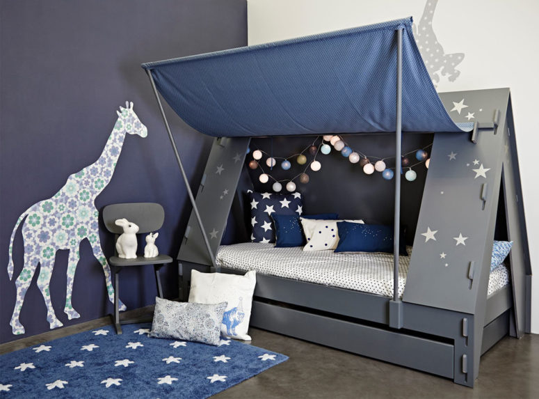 An awesome tent cabin bed in dark grey is perfect for a boy scout or girl guide. Stars are cool and creative touch. The bed is bade from pine and MDF. (Cuckooland)