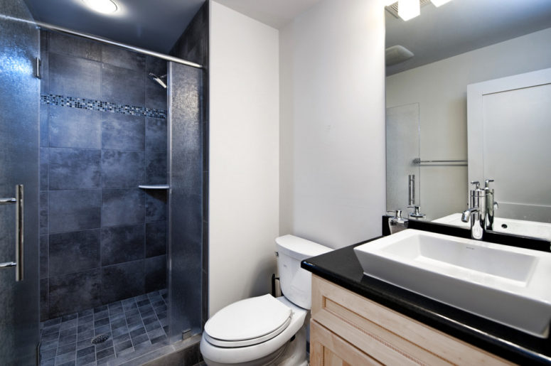 dark tiles are perfect for a walk-in shower but won't work well around the vanity (Moss Building and Design | Moss Home Services)