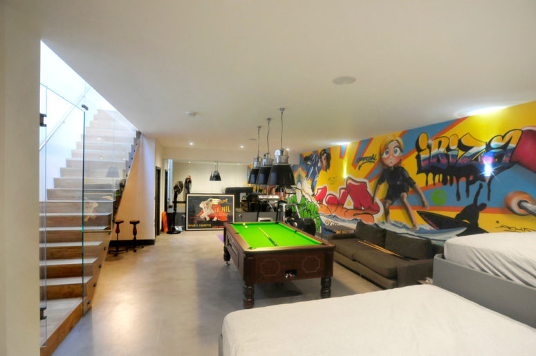 some graffiti would turn any basement into a happy place (Riach Architects)