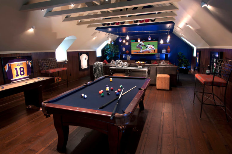 billiard's table and a dedicated TV area are perfect for a basement man cave (J. Hettinger Interiors)
