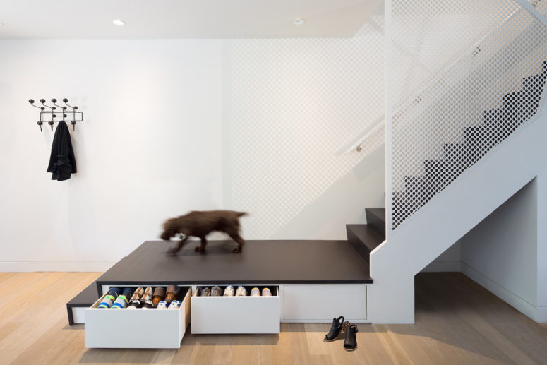 Not only space under stairs could be used for storage but stairs themselves could become functional drawers. (post Architecture)