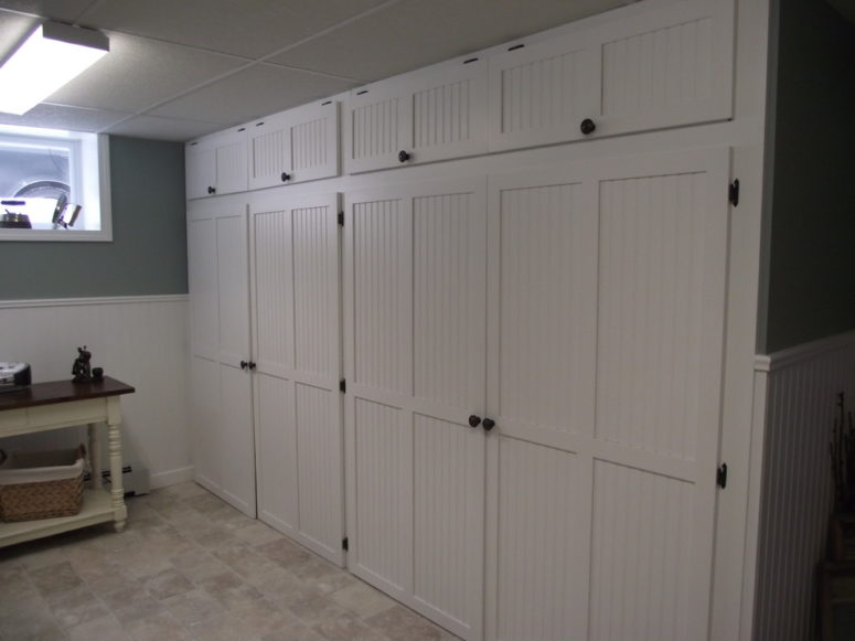 Floor to ceiling storage cabinets could be made by a carpenter.  (Carrie Greene Design)
