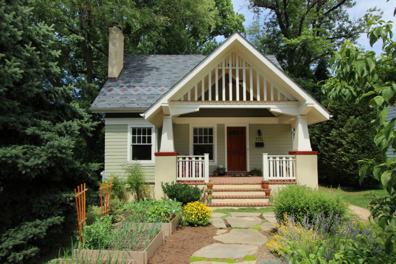 a small cottage with a beautiful front yard garden and a gable roof with gorgeous trim covering a porch (Bennett Frank McCarthy Architects, Inc.)