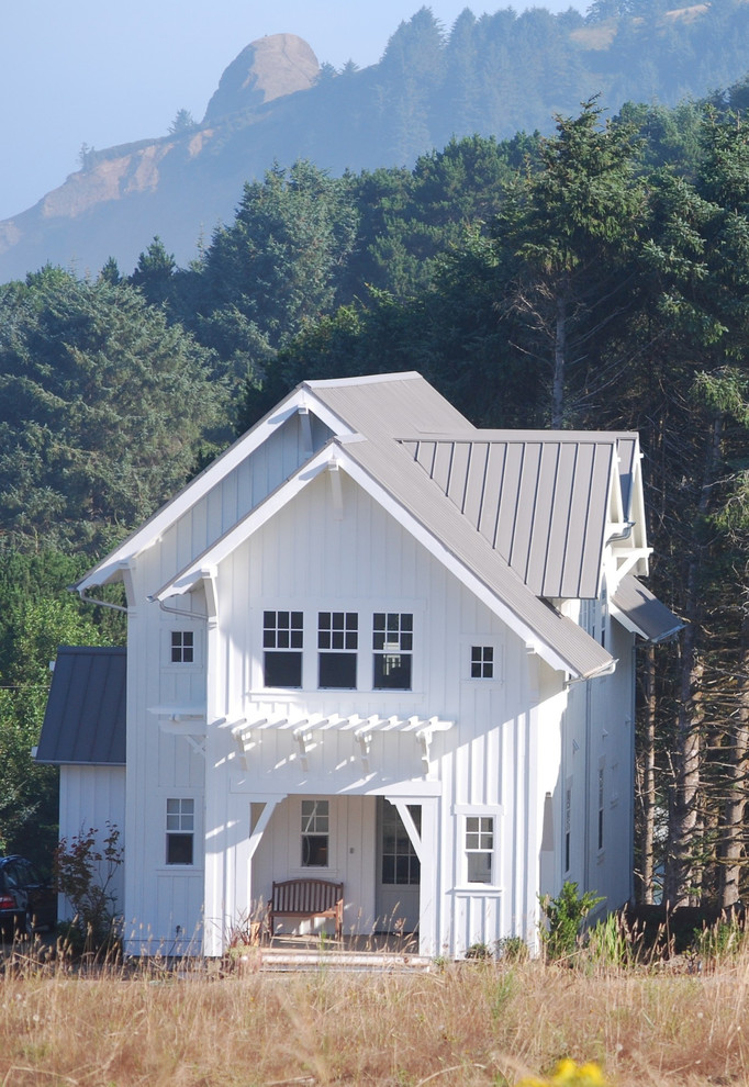 a mountain house with a small front porch and metal roofing (Duncan McRoberts Associates, LLC)
