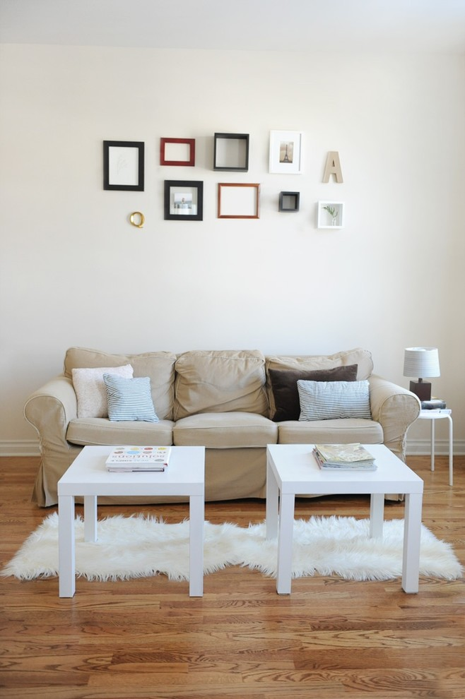 create a gallery wall above the sofa that complements its colors