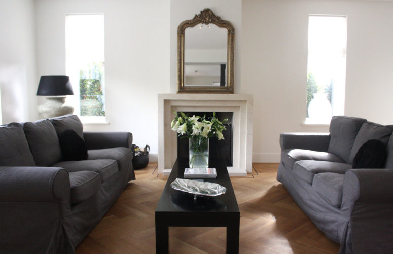 Two grey sofas in front of each other in a large living room